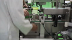 Supervisor monitors production line in factory Stock Footage