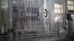 Factory production line machine injects bottles Stock Footage