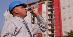 Developer Manager Man Drink Water Apartment Construction Development Sales Agent Stock Footage