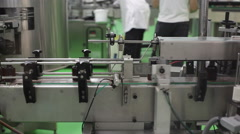 Bottles move on factory production line machines Stock Footage