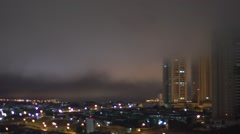 Time Lapse - city at night with fog through buildings Stock Footage