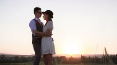 Couple hugging at sunset - stock footage