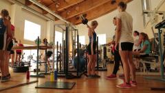 Dolly shot of Teenagers in a gym. Stock Footage