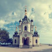 Orthodox church in Foros with sky and clouds - stock photo