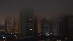 Time Lapse - city uildings covered with fog.  Stock Footage