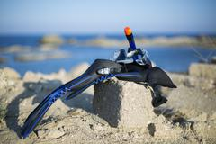Vacation Start Here Concept, Scuba Diving Equipment On The White Sea Sand Beach  - stock photo