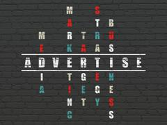 Marketing concept: word Advertise in solving Crossword Puzzle Stock Illustration