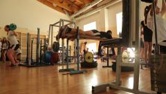 Young men working out in a gym. Stock Footage