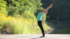 Girl practicing yoga - stock footage