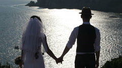 silhouette of a bride and groom on the background of the brilliant sea - stock footage