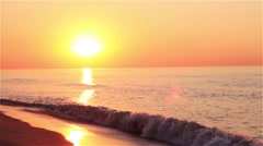 The sunrise with small wave on the sunny beach Stock Footage