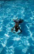 Man Reflection Diving in Swimming Pool Underwater - stock photo