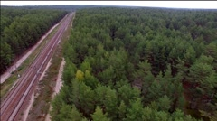 Aerial view of train over railway in the forest Stock Footage