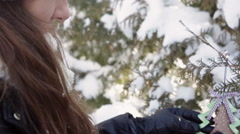 Beautiful Christmas woman decorates a fur-tree Stock Footage