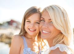Stock Photo of happy mother and child girl