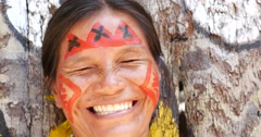 Native Brazilian woman at an indigenous tribe in the Amazon - stock footage
