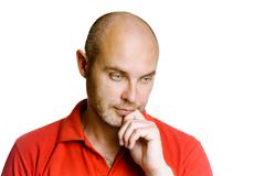 Thoughtful unshaven man on a white - stock photo