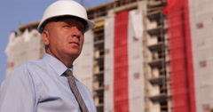 Builder Engineer Man Looking Around Construction Site Under Development Building Stock Footage