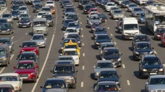 Traffic jam, dense slow flow of cars on a freeway  Stock Footage