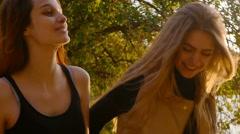 Friends,  girls, caucasians, having fun outdoors, walking, slow motion. - stock footage