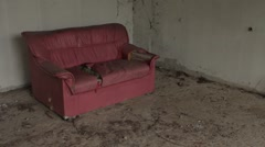 Abandoned Damaged Sofa Couch Chair Left In Derelict Building Hand Held Stock Footage