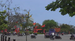 Chaotic traffic, the red flags are developed in the wind, the festive mood Stock Footage