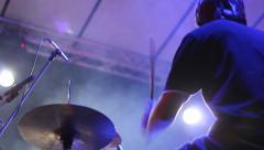 Rock concert Drummer backlit playing the drum set Stock Footage