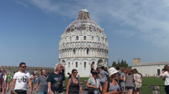 People walks in front of baptist cathedral in Pisa - stock footage