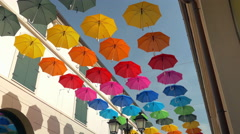 Street decorated with canopy of colorful umbrellas. - stock footage