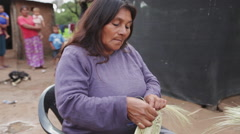 Woman sewing a traditional basket in the North of Argentina Stock Footage