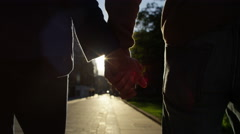 4K Low angle view of unrecognisable romantic couple, holding hands in city - stock footage