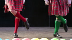 Clowns in Scottish kilts dancing on stage. - stock footage