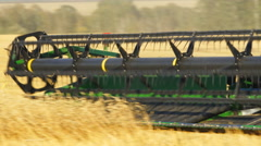 John Deere Combine harvester in a field Stock Footage