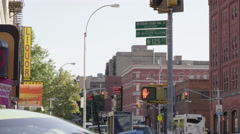 Intersection on 125th St and Martin Luther King Boulevard with signs in Harlem Stock Footage