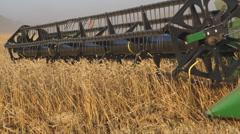 John Deere Combine harvester in a field - stock footage
