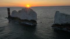 Aerial Drone Needles UK sea Helipad tourism sunset Stock Footage