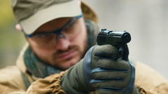 The player fires a BB gun. Airsoft game Stock Footage