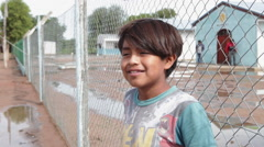 Young boy in a native village in North Argentina Stock Footage