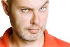 strict unshaven man on a white background. close up - stock photo