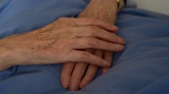 Grandmother's and grandchild's hands Stock Footage