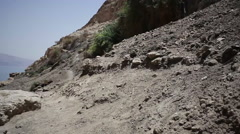 View of Jordan and the Dead Sea from desert oasis of Ein Gedi, pan left - stock footage