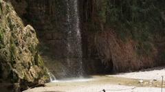 Waterfall in desert oasis spring, Ein Gedi, Israel - stock footage