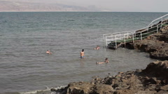 People float with mud at the Dead Sea, Israel, Palestine Stock Footage