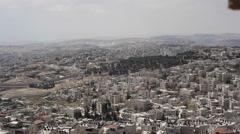 Separation security wall Israel Palestine, Jerusalem neighborhoods, pan left Stock Footage