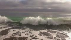 Ocean Surf Green Wave and Foam Pullback Aerial Stock Footage
