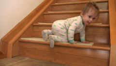 Baby's first stair climb in cute pajamas. Stock Footage