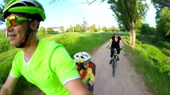 Happy Active Family Riding Bikes In Green Park Zone - stock footage