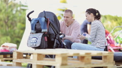 Stock Video Footage of family playing with a baby in a stroller