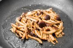 Cook mushrooms pan Stock Photos