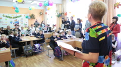 Stock Video Footage of Mature school teacher starts the lesson of Knowledge for pupils, Russia